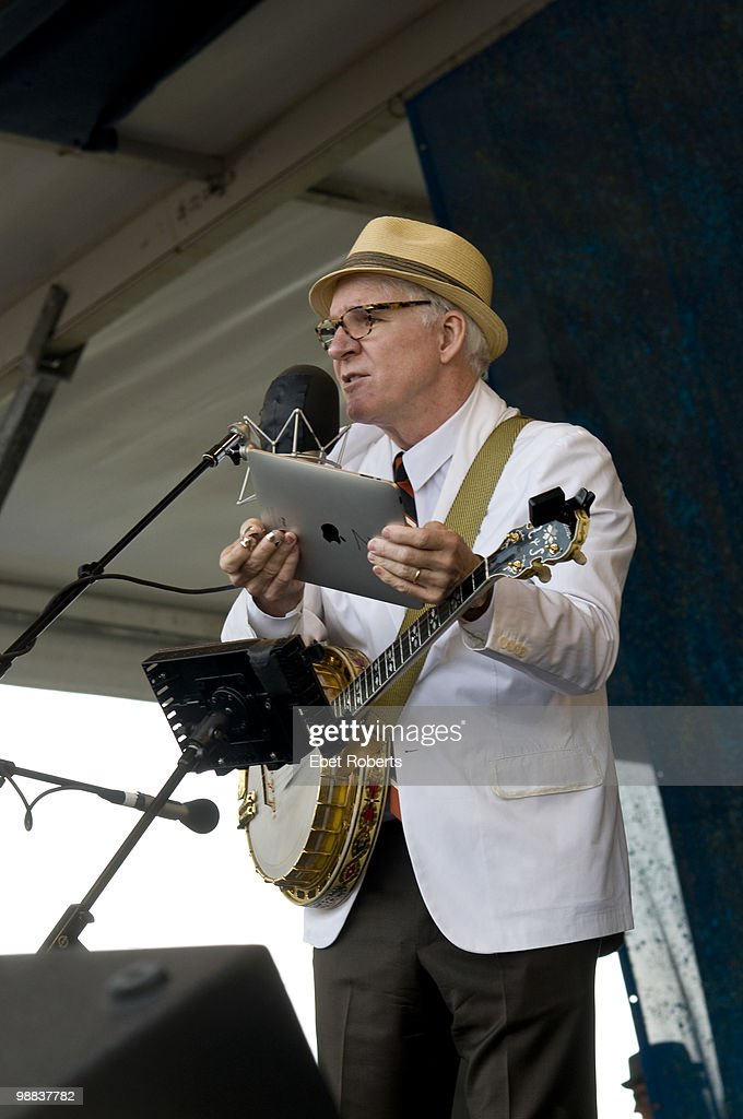 Steve Martin reading the set list off of the newly released ipad at the New Orleans Jazz & Heritage Festival on April 29, 2010 in New Orleans, Louisiana.