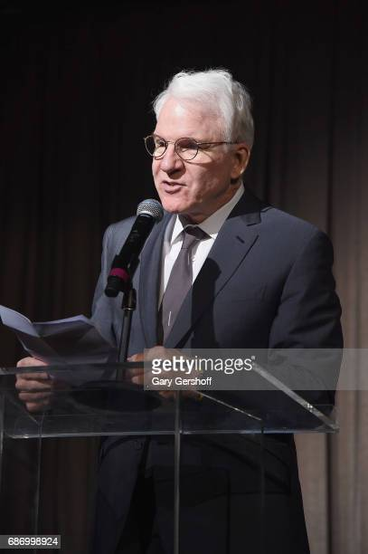 Steve Martin speaks on stage during the Elevator Repair Service Theater 25th Anniversary gala at Tribeca Rooftop on May 22 2017 in New York City