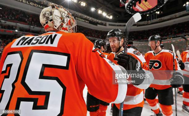 Steve Mason and Andrew MacDonald of the Philadelphia Flyers celebrate after defeating the Ottawa Senators 32 in a shootout on March 28 2017 at the...