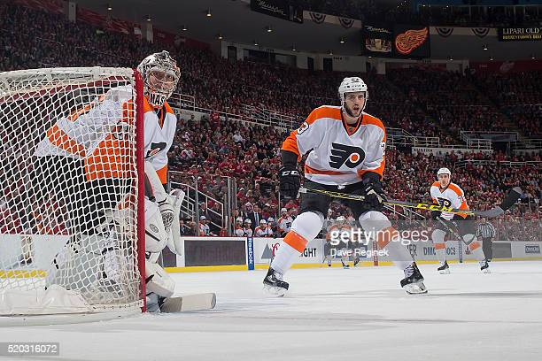 Steve Mason and Brandon Manning of the Philadelphia Flyers follows the play against the Detroit Red Wings during an NHL game at Joe Louis Arena on...