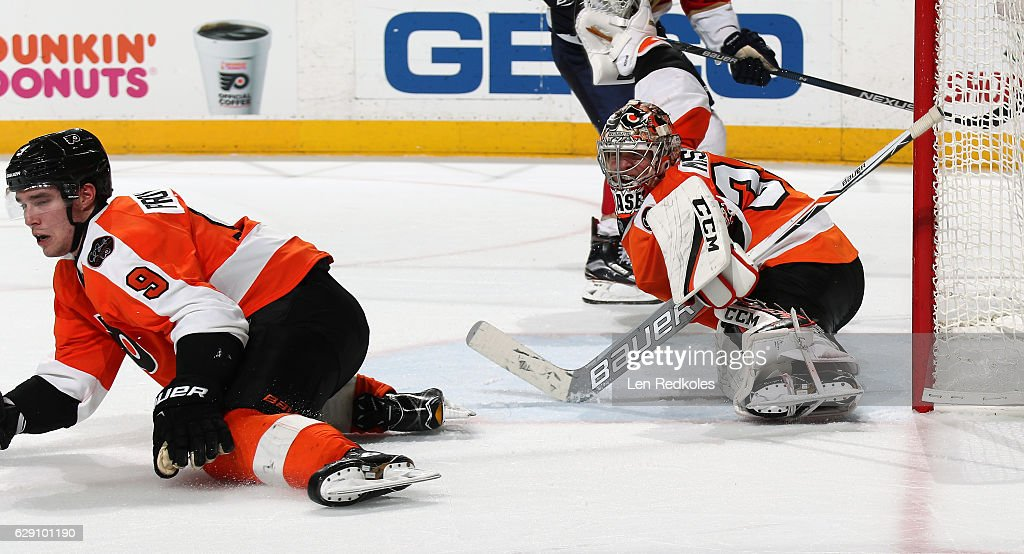 Steve Mason #35 and Ivan Provorov #9 of the Philadelphia Flyers react to a shot on goal against the Florida Panthers on December 6, 2016 at the Wells Fargo Center in Philadelphia, Pennsylvania.