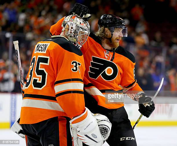 Steve Mason and Jakub Voracek of the Philadelphia Flyers celebrate the win over the Ottawa Senators at the Wells Fargo Center on April 2 2016 in...