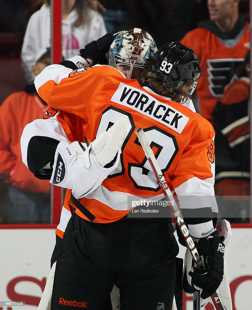 Steve Mason #35 and <a gi-track='captionPersonalityLinkClicked' href=/galleries/search?phrase=Jakub+Voracek&family=editorial&specificpeople=4111797 ng-click='$event.stopPropagation()'>Jakub Voracek</a> #93 of the Philadelphia Flyers embrace after defeating the New York Rangers 4-2 on April 16, 2013 at the Wells Fargo Center in Philadelphia, Pennsylvania. Mason earned his first win as a Flyer tonight.