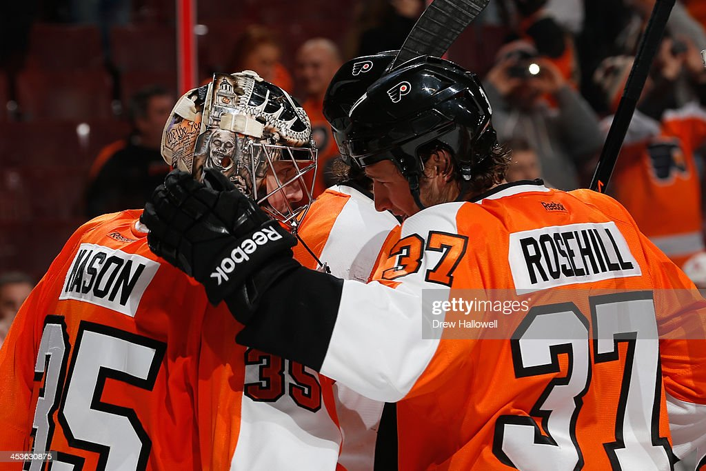 Steve Mason and Jay Rosehill of the Philadelphia Flyers celebrate a 52 win over the against the Ottawa Senators at the Wells Fargo Center on November...