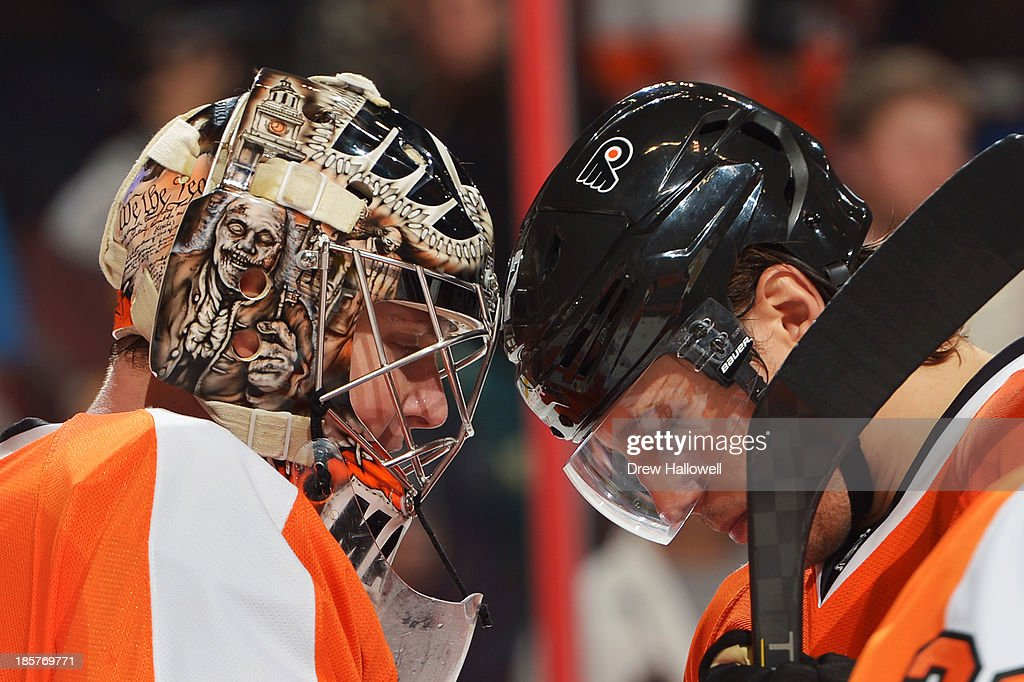 Steve Mason #35 and <a gi-track='captionPersonalityLinkClicked' href=/galleries/search?phrase=Luke+Schenn&family=editorial&specificpeople=4254202 ng-click='$event.stopPropagation()'>Luke Schenn</a> #22 of the Philadelphia Flyers bump heads after a 2-1 win over the New York Rangers at the Wells Fargo Center on October 24, 2013 in Philadelphia, Pennsylvania.