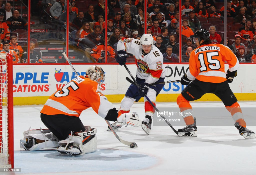 Steve Mason #35 and Michael Del Zotto #15 of the Philadelphia Flyers defend against Aleksander Barkov #16 of the Florida Panthers during the first period at the Wells Fargo Center on March 2, 2017 in Philadelphia, Pennsylvania.