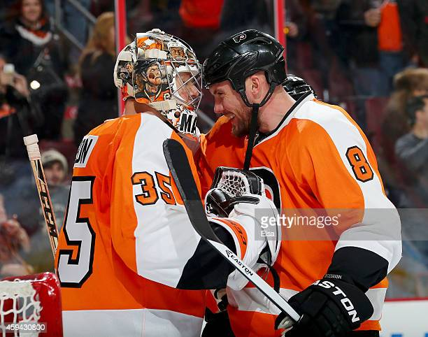 Steve Mason is congratulated by teammate Nicklas Grossmann of the Philadelphia Flyers after the win over the Columbus Blue Jackets on November 22...