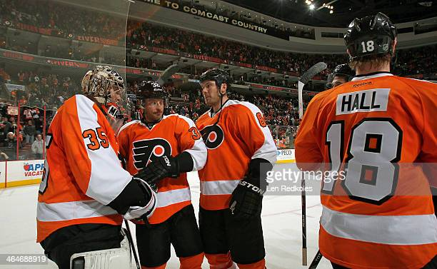 Steve Mason Mark Streit and Nicklas Grossmann of the Philadelphia Flyers celebrate a 31 win over the Montreal Canadiens on January 8 2014 at the...