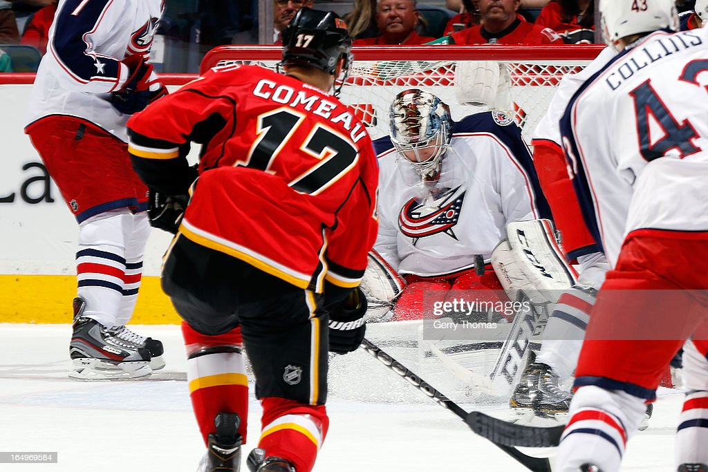 Steve Mason #1 of the Columbus Blue Jackets makes a save on a shot by <a gi-track='captionPersonalityLinkClicked' href=/galleries/search?phrase=Blake+Comeau&family=editorial&specificpeople=879782 ng-click='$event.stopPropagation()'>Blake Comeau</a> #17 of the Calgary Flames on March 29, 2013 at the Scotiabank Saddledome in Calgary, Alberta, Canada.