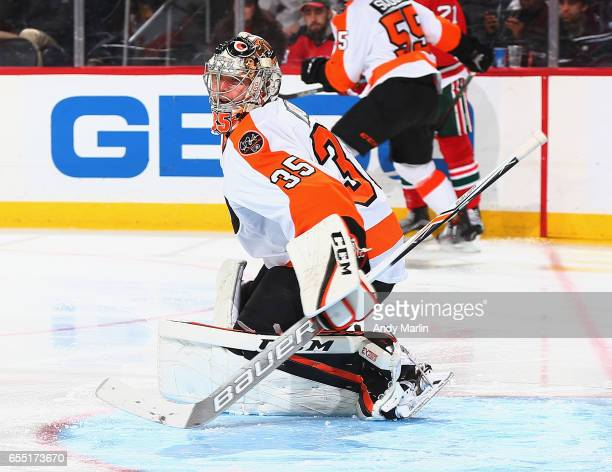 Steve Mason of the Philadelphia Flyerdefends his net against the New Jersey Devils during the game at Prudential Center on March 16 2017 in Newark...