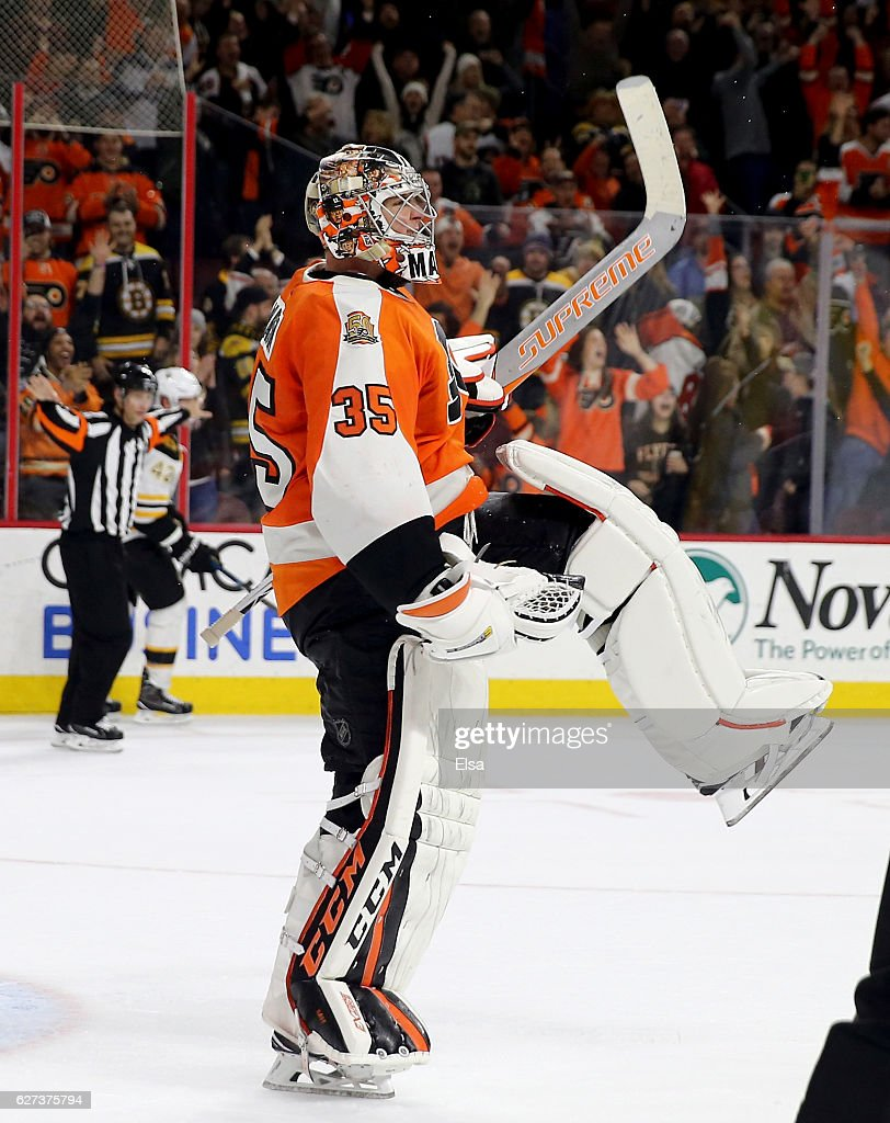 Steve Mason #35 of the Philadelphia Flyers celebrates after he made the game winning save in the overtime shootout against the Boston Bruins on November 29, 2016 at Wells Fargo Center in Philadelphia, Pennsylvania.The Philadelphia Flyers defeated the Boston Bruins 3-2 in an overtime shootout.