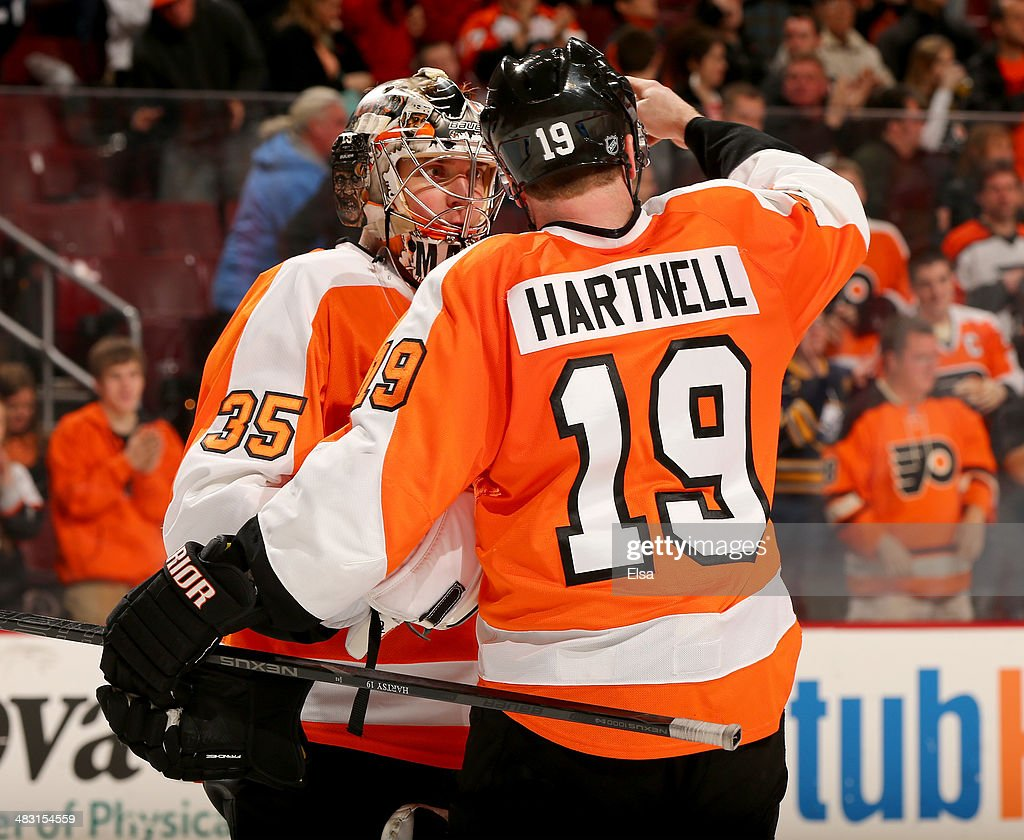 Steve Mason #35 of the Philadelphia Flyers celebrates the win with teammate <a gi-track='captionPersonalityLinkClicked' href=/galleries/search?phrase=Scott+Hartnell&family=editorial&specificpeople=201889 ng-click='$event.stopPropagation()'>Scott Hartnell</a> #19 after the game against the Buffalo Sabres at Wells Fargo Center on April 6, 2014 in Philadelphia, Pennsylvania.The Philadelphia Flyers defeated the Buffalo Sabres 5-2.