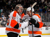 Steve Mason of the Philadelphia Flyers celebrates with Matt Read after a 43 win over the Pittsburgh Penguins on March 16 2014 at Consol Energy Center...