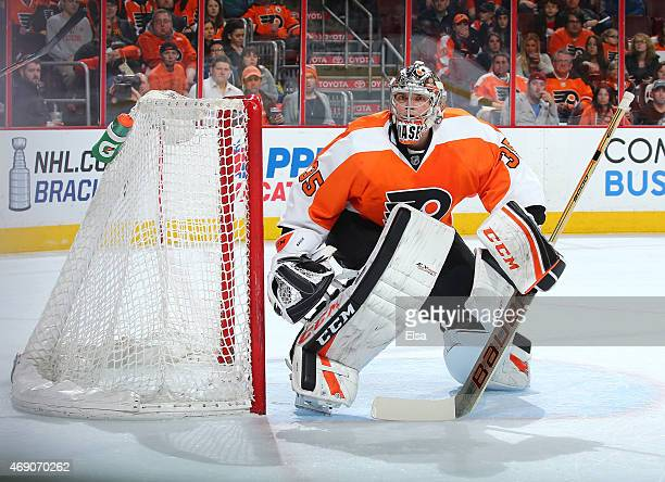 Steve Mason of the Philadelphia Flyers defends his net in the first period against the New York Islanders on April 7 2015 at the Wells Fargo Center...