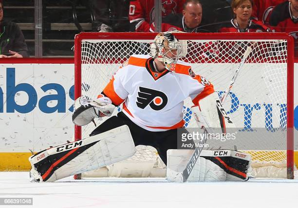 Steve Mason of the Philadelphia Flyers defends the net against the New Jersey Devils during the game at Prudential Center on April 4 2017 in Newark...