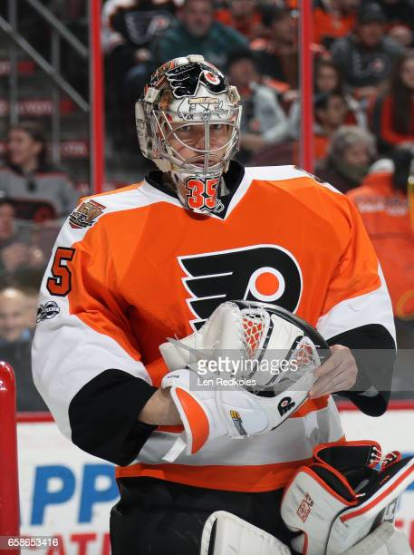 Steve Mason of the Philadelphia Flyers gathers himself during a stoppage in play against the Carolina Hurricanes on March 19 2017 at the Wells Fargo...