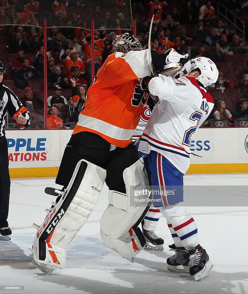 Steve Mason #35 of the Philadelphia Flyers hits <a gi-track='captionPersonalityLinkClicked' href=/galleries/search?phrase=Brian+Gionta&family=editorial&specificpeople=202116 ng-click='$event.stopPropagation()'>Brian Gionta</a> #21 of the Montreal Canadiens at the closing buzzer during the Flyers 2-1 victory over the Canadiens at the Wells Fargo Center on December 12, 2013 in Philadelphia, Pennsylvania.