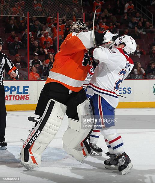 Steve Mason of the Philadelphia Flyers hits Brian Gionta of the Montreal Canadiens at the closing buzzer during the Flyers 21 victory over the...