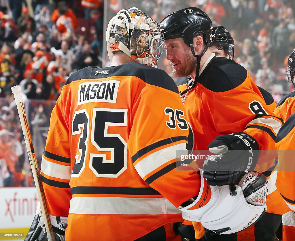 Steve Mason of the Philadelphia Flyers is congratulated by Nicklas Grossmann after the game against the Pittsburgh Penguins on April 5 2015 at the...