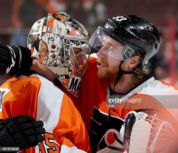 Steve Mason of the Philadelphia Flyers is congratulated by teammate Jakub Voracek after the shut out against the Vancouver Canucks on December 17...