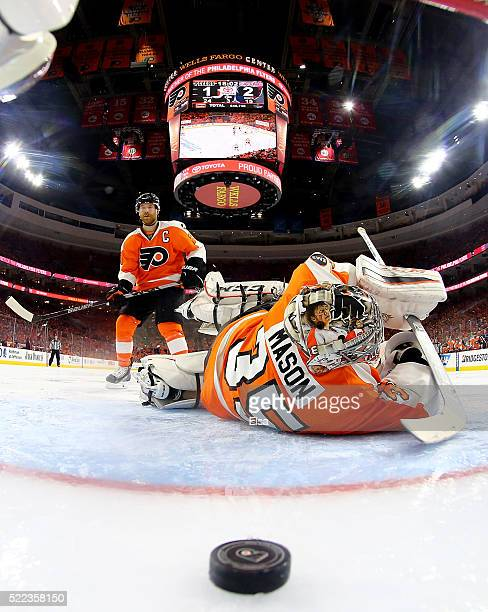 Steve Mason of the Philadelphia Flyers is unable to stop a shot by Evgeny Kuznetsov of the Washington Capitals in the third period in Game Three of...