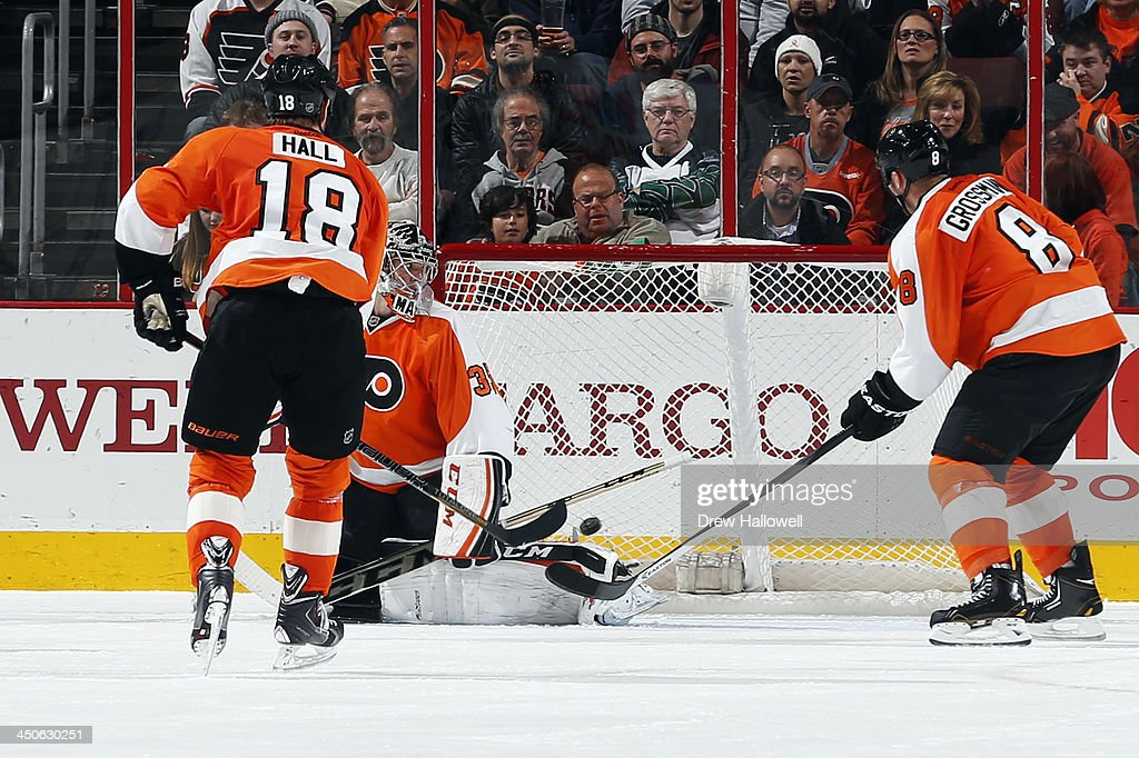 Steve Mason #35 of the Philadelphia Flyers is unable to stop the puck on a shot by Colin Greening #14 of the Ottawa Senators, as Adam Hall #18 and Nicklas Grossmann #8 look on at the Wells Fargo Center on November 19, 2013 in Philadelphia, Pennsylvania.