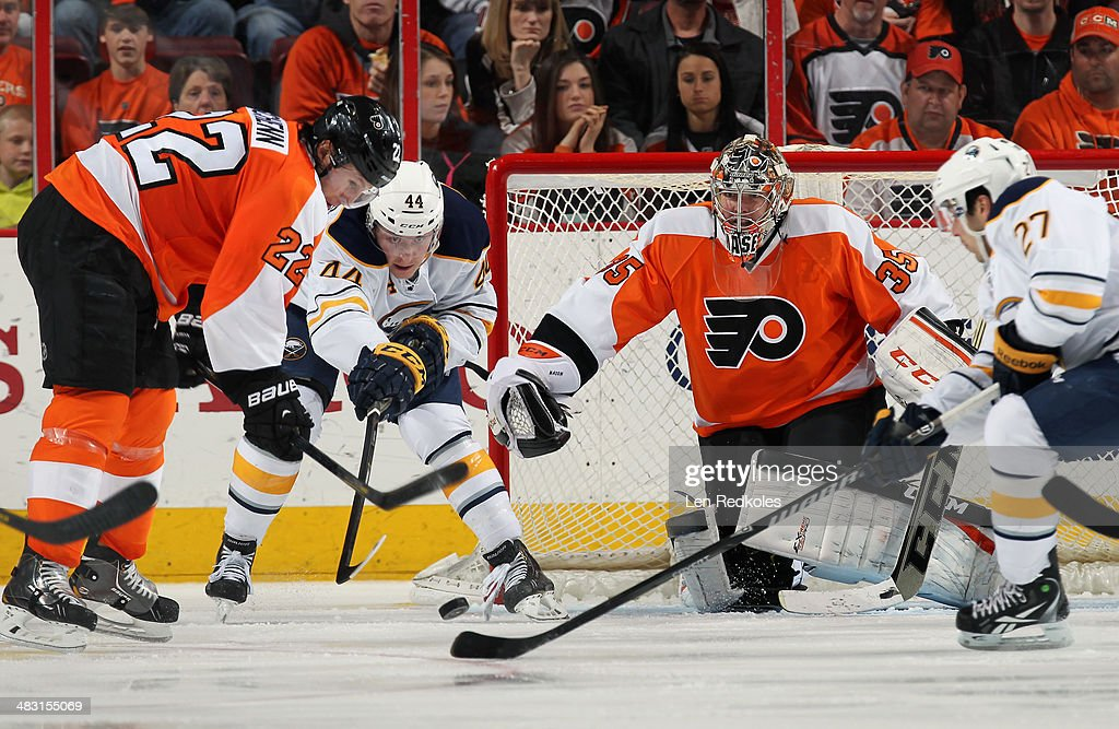 Steve Mason #35 of the Philadelphia Flyers keeps his eyes on the loose puck while <a gi-track='captionPersonalityLinkClicked' href=/galleries/search?phrase=Luke+Schenn&family=editorial&specificpeople=4254202 ng-click='$event.stopPropagation()'>Luke Schenn</a> #22 defends against Nicolas Deslauriers #44 of the Buffalo Sabres on April 6, 2014 at the Wells Fargo Center in Philadelphia, Pennsylvania. The Flyers went on to defeat the Sabres 5-2.