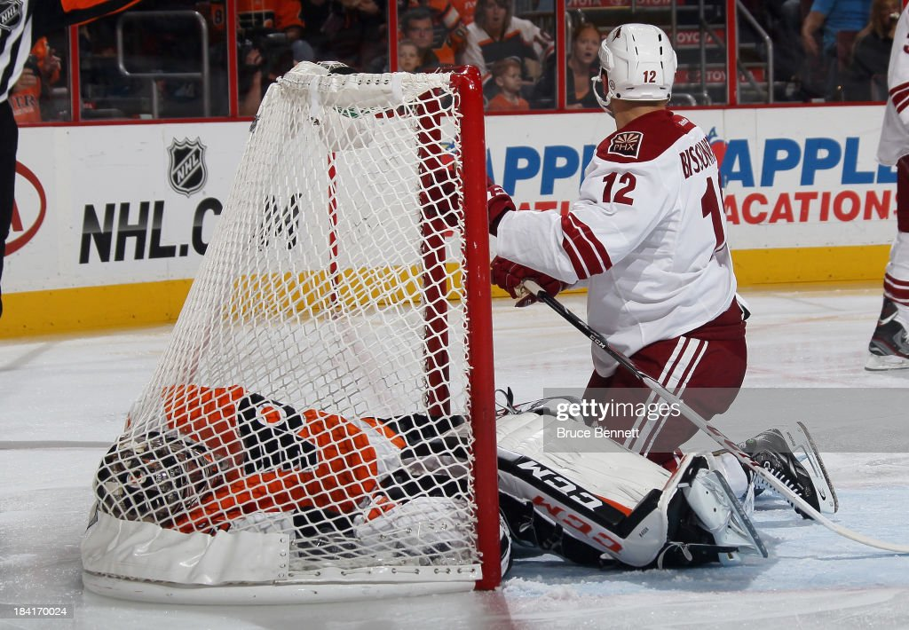 Steve Mason #35 of the Philadelphia Flyers lands in the back of the net after being pushed in by a falling <a gi-track='captionPersonalityLinkClicked' href=/galleries/search?phrase=Paul+Bissonnette&family=editorial&specificpeople=2235151 ng-click='$event.stopPropagation()'>Paul Bissonnette</a> #12 of the Phoenix Coyotes at the Wells Fargo Center on October 11, 2013 in Philadelphia, Pennsylvania. The Coyotes defeated the Flyers 2-1.