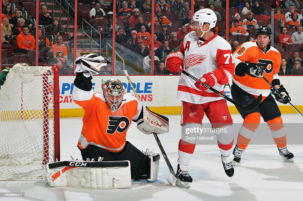 Steve Mason #35 of the Philadelphia Flyers makes a glove save in front of <a gi-track='captionPersonalityLinkClicked' href=/galleries/search?phrase=Daniel+Cleary&family=editorial&specificpeople=220490 ng-click='$event.stopPropagation()'>Daniel Cleary</a> #71 of the Detroit Red Wings and Red Wings teammate <a gi-track='captionPersonalityLinkClicked' href=/galleries/search?phrase=Nicklas+Grossman&family=editorial&specificpeople=2284863 ng-click='$event.stopPropagation()'>Nicklas Grossman</a>n at the Wells Fargo Center on January 28, 2014 in Philadelphia, Pennsylvania. The Flyers won 5-0.