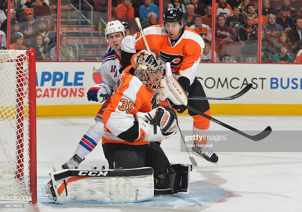 Steve Mason #35 of the Philadelphia Flyers makes a save against the New York Rangers at the Wells Fargo Center on October 24, 2013 in Philadelphia, Pennsylvania. The Flyers won 2-1.