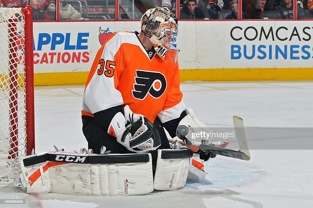 Steve Mason #35 of the Philadelphia Flyers makes a save against the Detroit Red Wings at the Wells Fargo Center on January 28, 2014 in Philadelphia, Pennsylvania. The Flyers won 5-0.