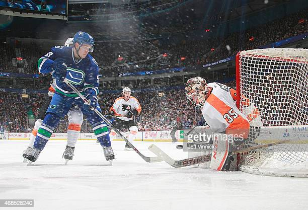 Steve Mason of the Philadelphia Flyers makes a save off the shot of Bo Horvat of the Vancouver Canucks during their NHL game at Rogers Arena March 17...