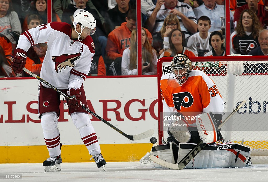 Steve Mason #35 of the Philadelphia Flyers makes a save on a deflected shot by <a gi-track='captionPersonalityLinkClicked' href=/galleries/search?phrase=Martin+Hanzal&family=editorial&specificpeople=2109469 ng-click='$event.stopPropagation()'>Martin Hanzal</a> #11 of the Phoenix Coyotes on October 11, 2013 at the Wells Fargo Center in Philadelphia, Pennsylvania. The Coyotes went on to defeat the Flyers 2-1.