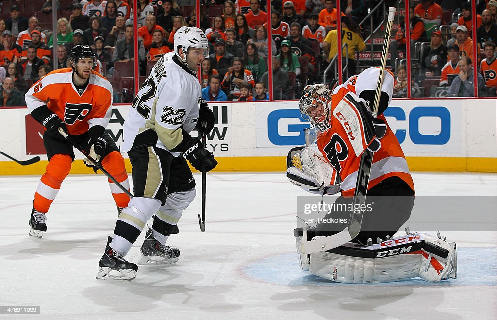 Steve Mason #35 of the Philadelphia Flyers makes a shoulder save as Braydon Coburn #5 skates in to defend against Lee Stempniak #22 of the Pittsburgh Penguins on March 15, 2014 at the Wells Fargo Center in Philadelphia, Pennsylvania.