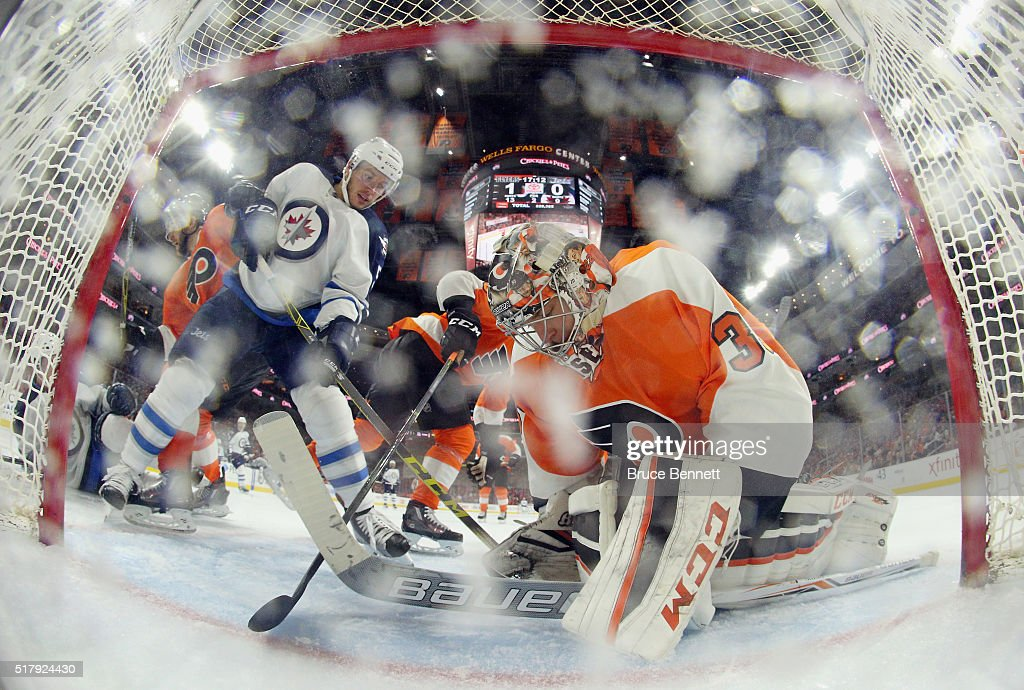 Steve Mason #35 of the Philadelphia Flyers makes the save as Marko Dano #56 of the Winnipeg Jets looks for the rebound at the Wells Fargo Center on March 28, 2016 in Philadelphia, Pennsylvania. The Flyers defeated the Jets 3-2 in overtime.