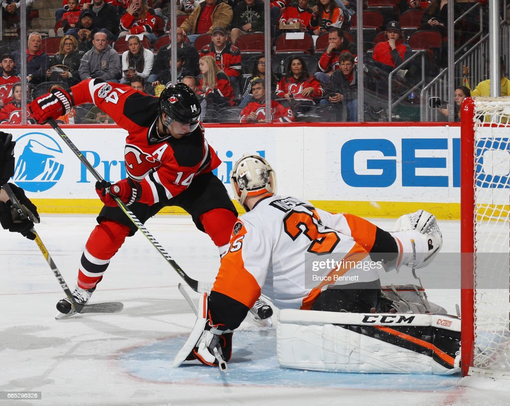 Steve Mason #35 of the Philadelphia Flyers makes the save on Adam Henrique #14 of the New Jersey Devils at the Prudential Center on April 4, 2017 in Newark, New Jersey.
