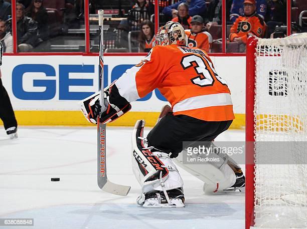 Steve Mason of the Philadelphia Flyers plays the puck against the New York Rangers on January 4 2017 at the Wells Fargo Center in Philadelphia...