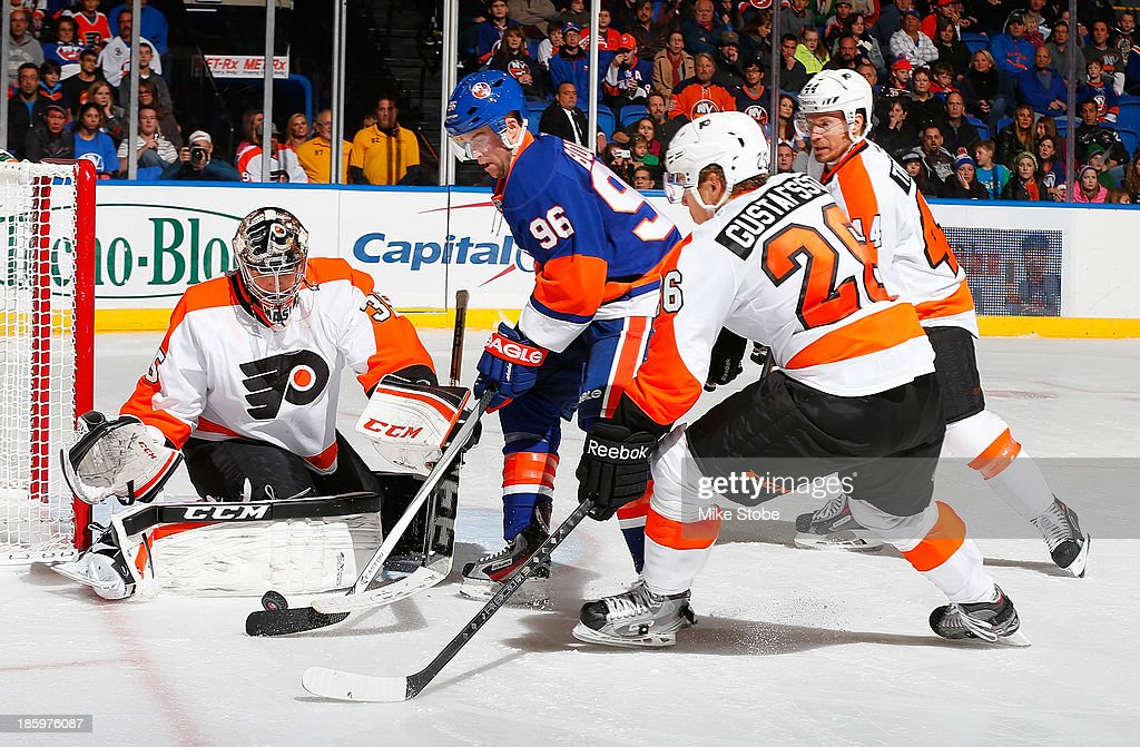 Steve Mason #35 of the Philadelphia Flyers protects the net as Pierre-Marc Bouchard #96 of the New York Islanders plays the puck at Nassau Veterans Memorial Coliseum on October 26, 2013 in Uniondale, New York. The Flyers defeated the Islanders 5-2.
