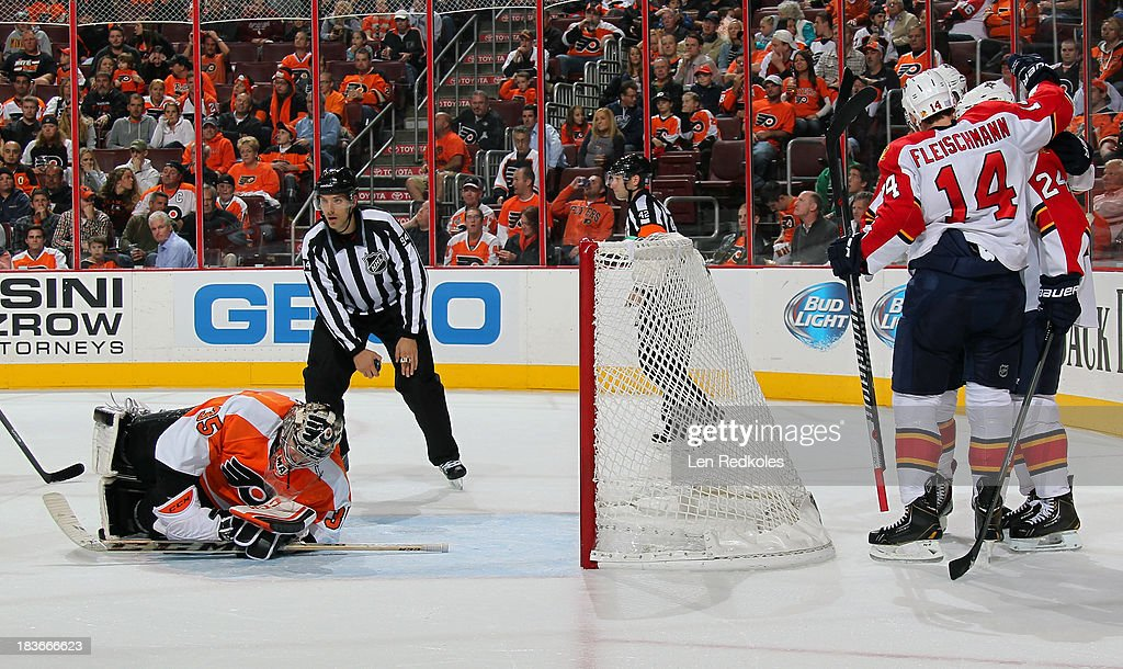 Steve Mason #35 of the Philadelphia Flyers reacts as <a gi-track='captionPersonalityLinkClicked' href=/galleries/search?phrase=Tomas+Fleischmann&family=editorial&specificpeople=554398 ng-click='$event.stopPropagation()'>Tomas Fleischmann</a> #14 and <a gi-track='captionPersonalityLinkClicked' href=/galleries/search?phrase=Brad+Boyes&family=editorial&specificpeople=275014 ng-click='$event.stopPropagation()'>Brad Boyes</a> #24 of the Florida Panthers celebrate Boyes' goal in the second period on October 8, 2013 at the Wells Fargo Center in Philadelphia, Pennsylvania.