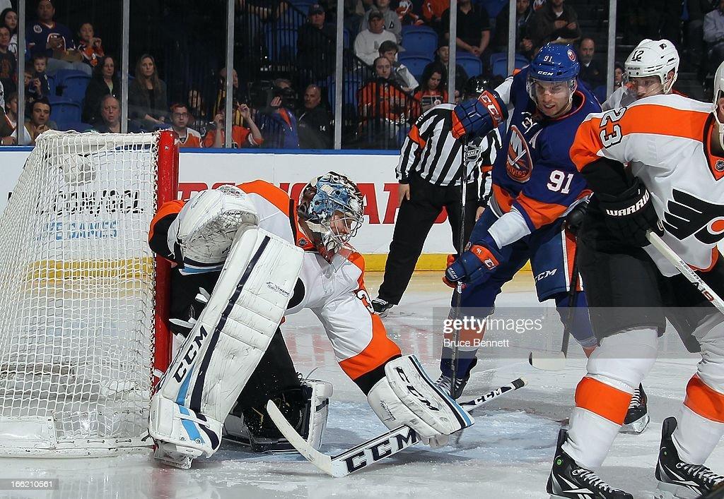 Steve Mason #35 of the Philadelphia Flyers skates against the New York Islanders at the Nassau Veterans Memorial Coliseum on April 9, 2013 in Uniondale, New York. The Islanders defeated the Flyers 4-1.