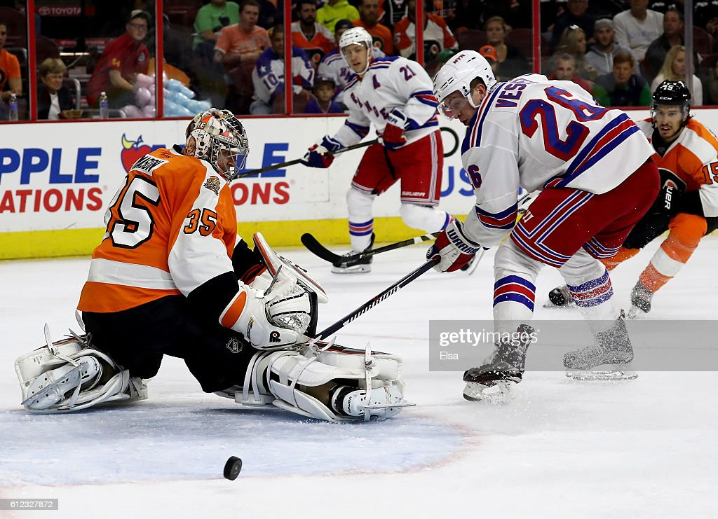 Steve Mason #35 of the Philadelphia Flyers stops a shot by Jimmy Vesey #26 of the New York Rangers in the first period during a preseason game on October 3, 2016 at Wells Fargo Center in Philadelphia, Pennsylvania.