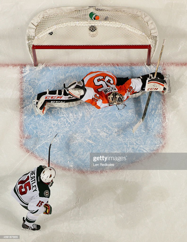 Steve Mason #35 of the Philadelphia Flyers surrenders a goal by Mikael Granlund #64 of the Minnesota Wild(not pictured) while <a gi-track='captionPersonalityLinkClicked' href=/galleries/search?phrase=Dany+Heatley&family=editorial&specificpeople=202142 ng-click='$event.stopPropagation()'>Dany Heatley</a> #15 watches on December 23, 2013 at the Wells Fargo Center in Philadelphia, Pennsylvania. The Flyers defeated the Wild 4-1.