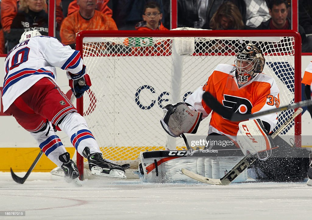 Steve Mason #35 of the Philadelphia Flyers surrenders a goal to <a gi-track='captionPersonalityLinkClicked' href=/galleries/search?phrase=J.T.+Miller&family=editorial&specificpeople=4663469 ng-click='$event.stopPropagation()'>J.T. Miller</a> #10 of the New York Rangers in the third period on October 24, 2013 at the Wells Fargo Center in Philadelphia, Pennsylvania. The goal was overturned after it was determined Miller had used a kicking motion to score the goal. The Flyers went on to defeat the Rangers 2-1.