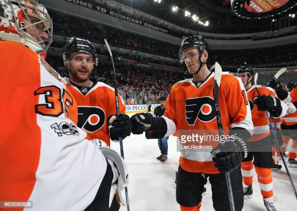 Steve Mason Sean Couturier and Andrew MacDonald of the Philadelphia Flyers celebrate after defeating the Ottawa Senators 32 in a shootout on March 28...