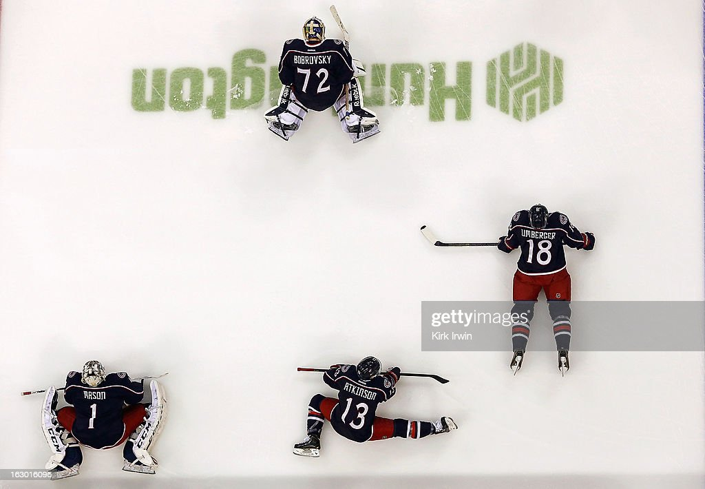 Steve Mason #1, Sergei Bobrovsky #72, Cam Atkinson #13, and R.J. Umberger #18, all of the Columbus Blue Jackets, stretch prior to the start of the game against the Colorado Avalanche on March 3, 2013 at Nationwide Arena in Columbus, Ohio.