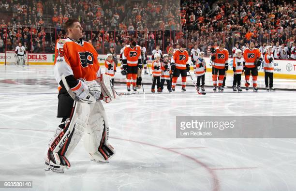 Steve Mason Shayne Gostisbehere Wayne Simmonds Jordan Weal Valtteri Filppula and Michael Del Zotto of the Philadelphia Flyers stand during the...