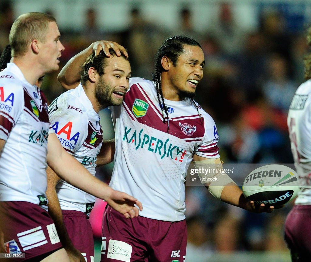 Steve Matai of the Sea Eagles celebrates with Brett Stewart after scoring a try during the round 18 NRL match between the North Queensland Cowboys and the Manly Sea Eagles at 1300SMILES Stadium on July 15, 2013 in Townsville, Australia.