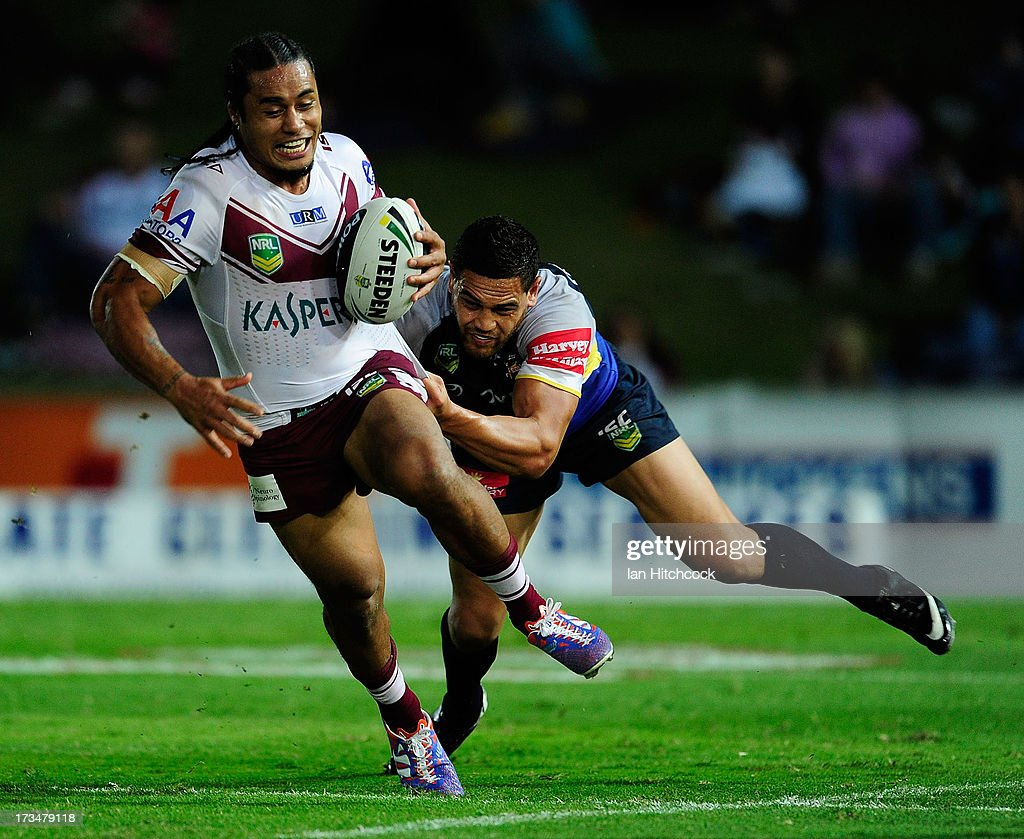Steve Matai of the Sea Eagles is tackled by Antonio Winterstein of the Sea Eagles during the round 18 NRL match between the North Queensland Cowboys and the Manly Sea Eagles at 1300SMILES Stadium on July 15, 2013 in Townsville, Australia.