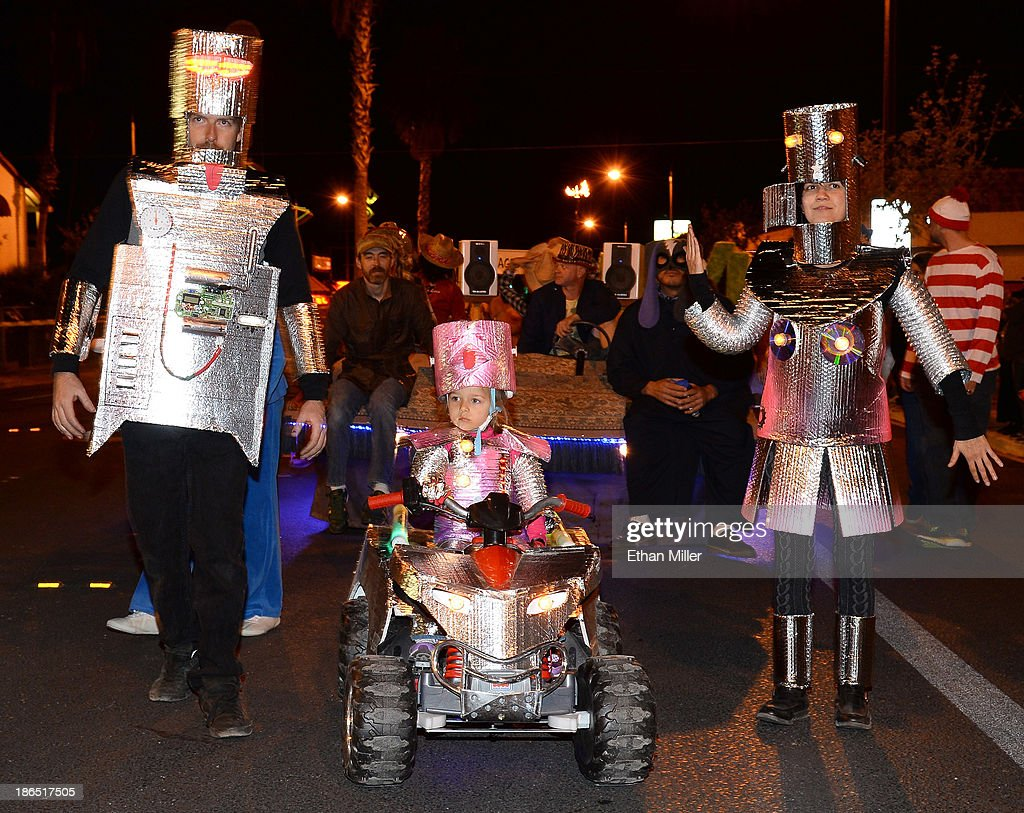 Steve McAnulty, Zoe McAnulty, 3, and Tara Pierce, all of Nevada, participate in the fourth annual Las Vegas Halloween Parade on October 31, 2013 in Las Vegas, Nevada.