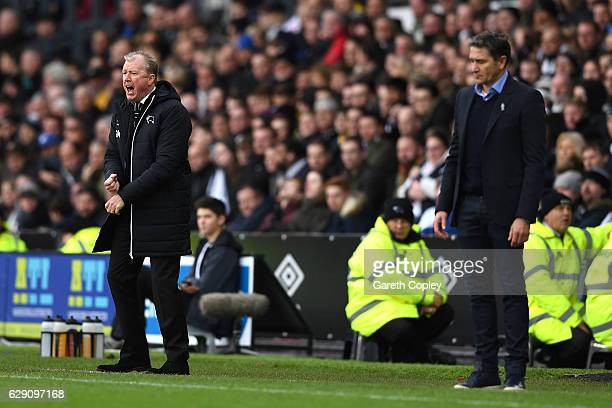 Steve McClaren Manager of Derby County and Manager of Nottingham Forest Philippe Montanier look on during the Sky Bet Championship match between...